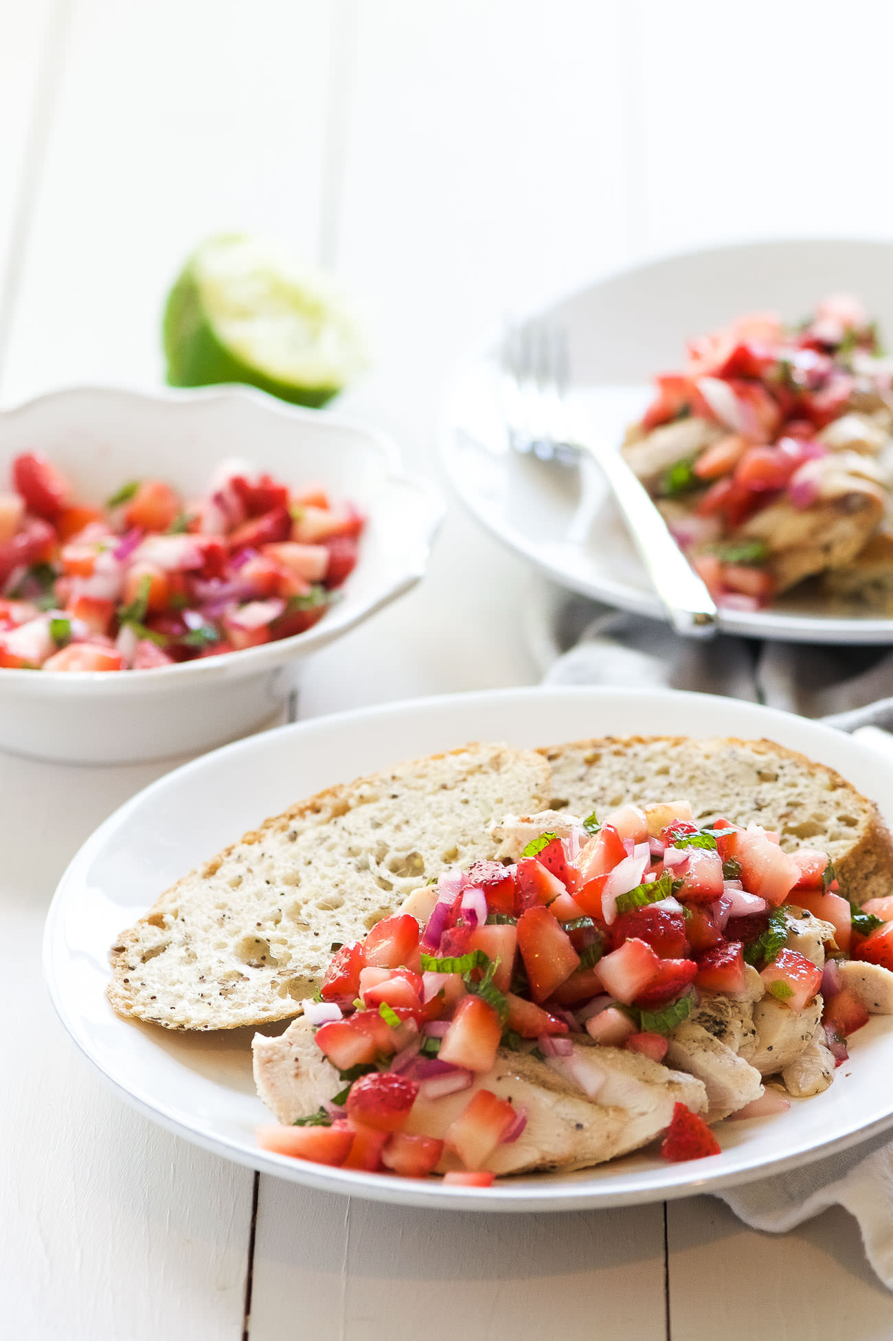 Balsamic Grilled Chicken with Strawberry Mint Salsa is a fresh spin on dinner! Fresh strawberries, mint and lime make the ideal summer topping for juicy grilled chicken!