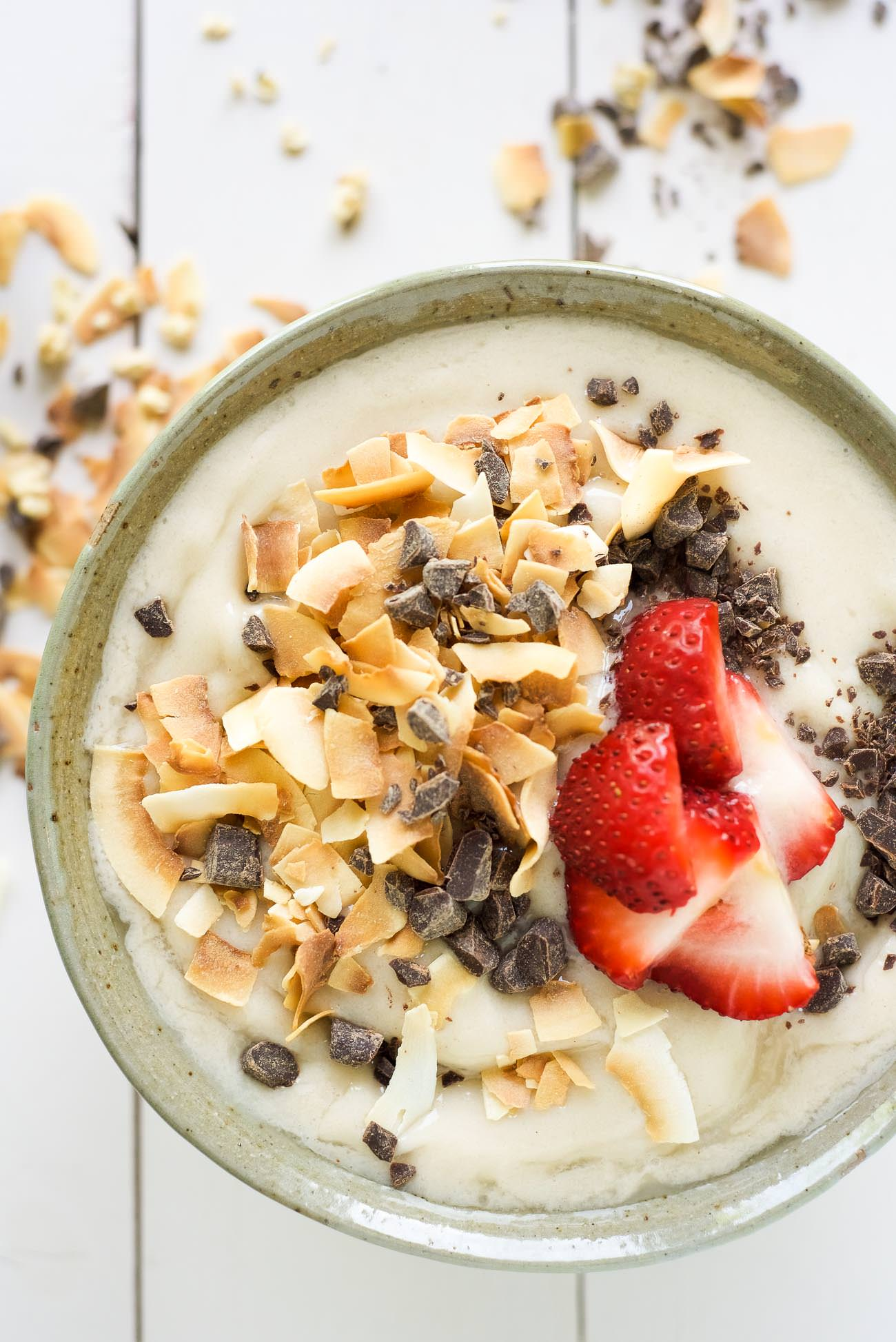 Dark Chocolate and Toasted Coconut Smoothie Bowl is a nutritious and fun twist on a smoothie! Filled with tropical flavors of banana and coconut and topped with dark chocolate, fruit, granola and chia seeds!