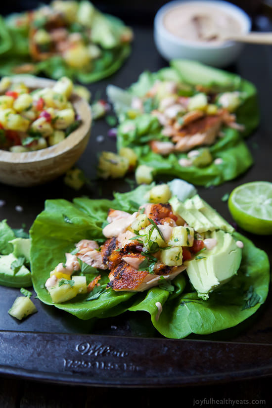 The perfect healthy twist on the original fish tacos! These Southwestern Grilled Salmon Tacos are bursting with flavor and topped with fresh pineapple salsa and a Chipotle Lime Crema! Addicting!
