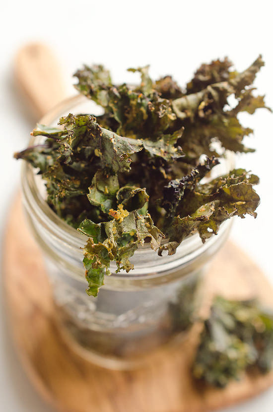 Spicy Kale Chips are beautifully crispy and loaded with bold chipotle flavor for a healthy 5 ingredient vegan snack! They are perfect for the munchies or paired with your favorite sandwich on the side!