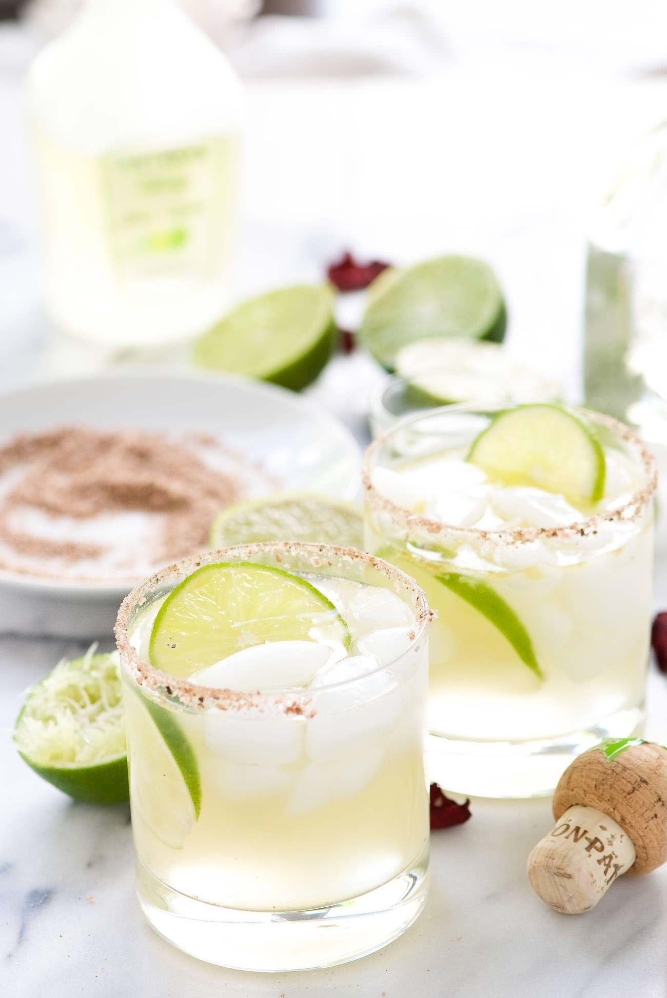 Spice your margarita with this Spicy Rosa Picante Margarita for Patron Margarita of the Year! Fresh lime juice, ginger, a bit of jalapeno and rose water make this one top shelf margarita!
