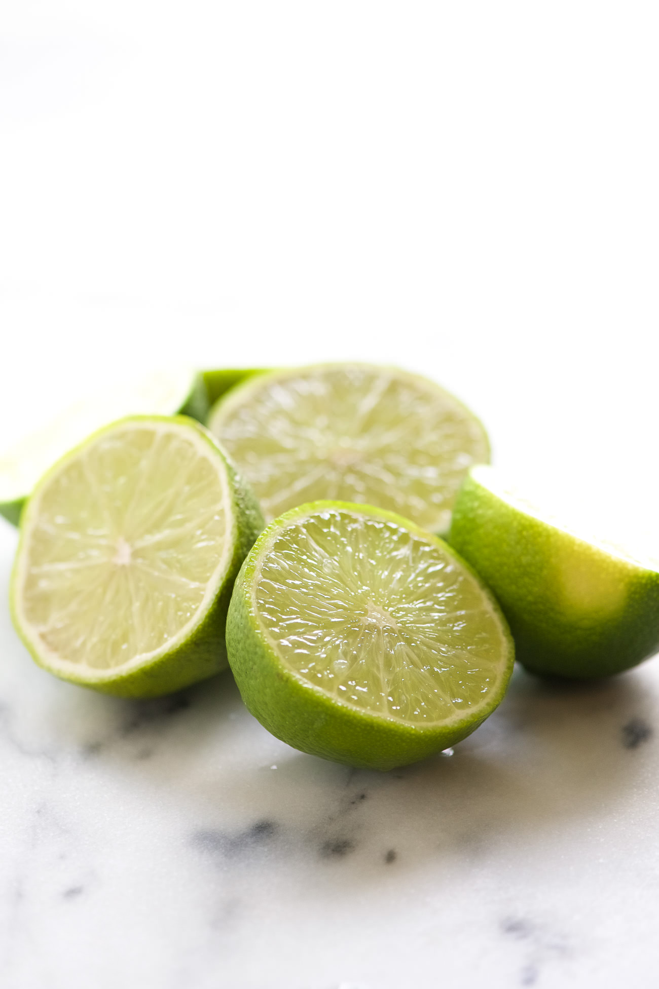 This is the best Spicy Margarita recipe out there! Starts with a base of fresh lime juice, silver tequila and agave then spiced with a bit of jalapeño for a refreshing cocktail!