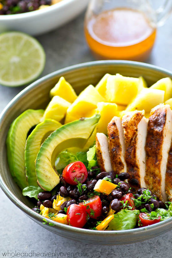 These Tropical Grilled Chicken Mexican Salad Bowls are filled with kickin' grilled chicken, sweet pineapple, and lots of Mexican goodness collide! A zippy chipotle vinaigrette drizzled on top makes all the flavors sing!