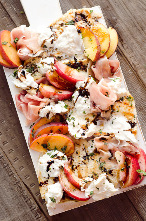 Balsamic Chicken with Peaches & Prosciutto is a deliciously simple and healthy dinner made on the grill in just 10 minutes! Grilled chicken is topped with fresh peaches and burrata cheese. Then, finished off with a balsamic reduction and basil for a low carb recipe that will make everyone's mouth water!