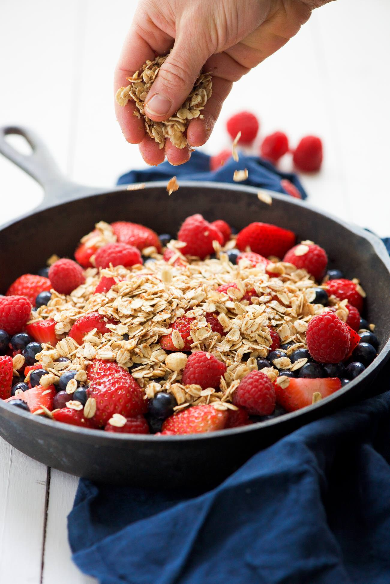 Gluten Free Vanilla Triple Berry Crisp is a simple 8 ingredient dessert that is bursting with fresh berries that bake into a juicy sauce; then topped with a sugary oatmeal topping. A gluten free and vegan dessert that is healthy enough for a breakfast treat!