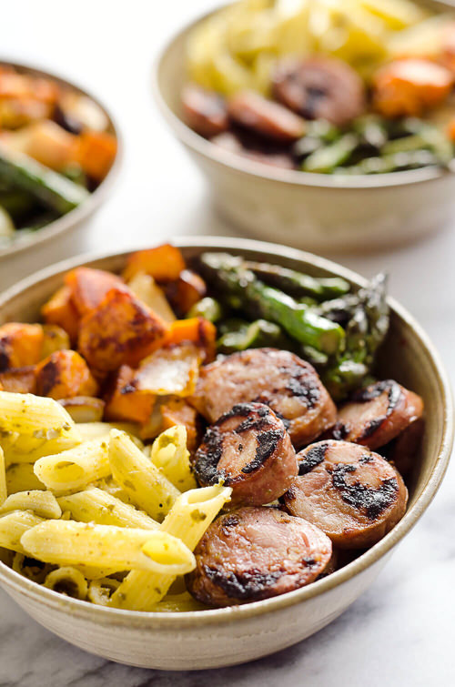 Roasted Veggie & Chicken Sausage Penne Bowls are a healthy dinner bursting with bold flavors and wholesome ingredients. With chipotle roasted sweet potatoes and chicken & apple sausage tossed in pesto, this dish is a well-rounded and satisfying meal you will love.