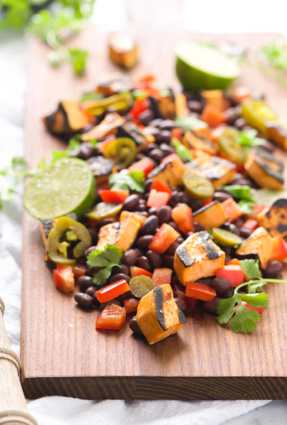 Take your dinner outside with this Southwestern Grilled Sweet Potato Salad! Sweet potatoes caramelize on the grill and then mixed with black beans, charred corn, jalapenos, red pepper, onion and dressed with lime and cilantro. Try it hot off the grill or chilled - can't go wrong either way!