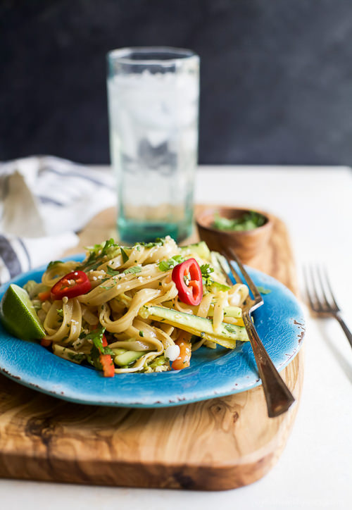Asian Noodle Salad with a Spicy Sesame Dressing is easy to make, low in calories and bursting with flavor. Once you try this you'll be craving it all the time.
