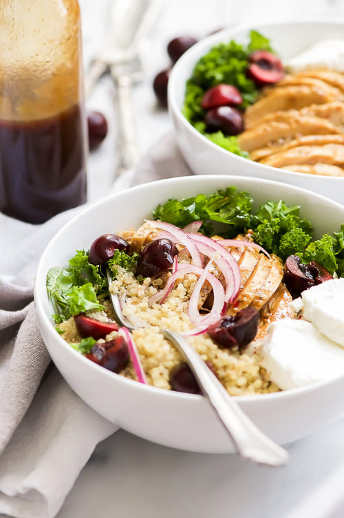 Honey Balsamic Glazed Chicken Quinoa Bowls are a hearty and flavor meal! Juicy chicken is coated in a sticky, sweet balsamic glaze then paired with fluffy quinoa, creamy goat cheese, and fresh cherries. A perfect make ahead meal!