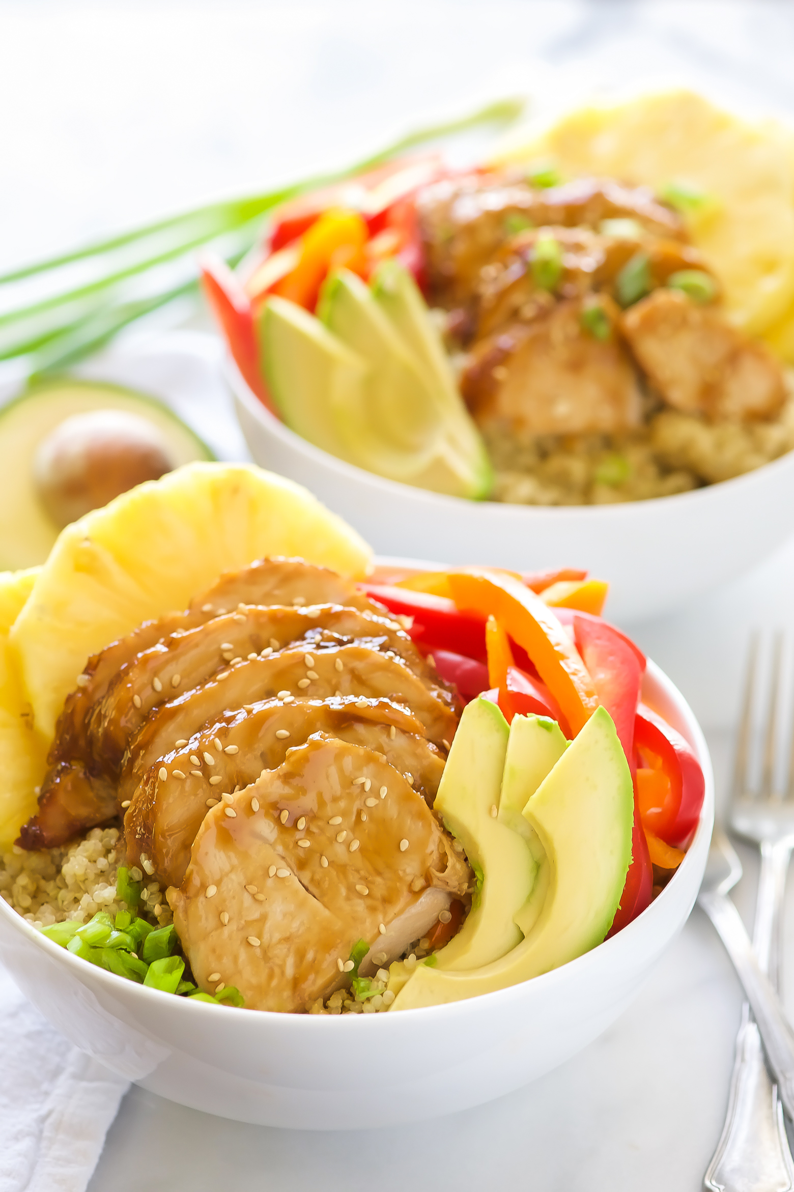 Honey Soy Glazed Hawaiian Bowls pack a serious flavor punch! Honey soy glazed turkey tenderloins are baked then added to bowl filled with rice, juicy pineapple, peppers, onions, and avocados. This one dish wonder is perfect for any weeknight dinner!