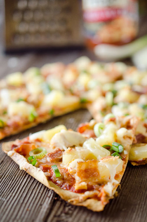 Light Pineapple, Chicken & Bacon Pizza is an easy and healthy dinner for two with juicy pineapple, sharp Manchego cheese shredded chicken and crisp bacon on a thin and crispy tortilla crust.