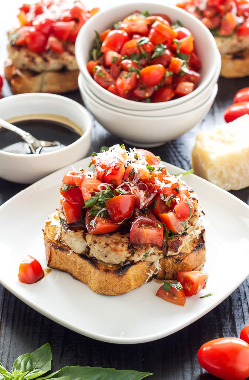 Turkey Bruschetta Burgers are juicy burgers served on toasted french bread with parmesan cheese and topped with fresh tomato basil salad!
