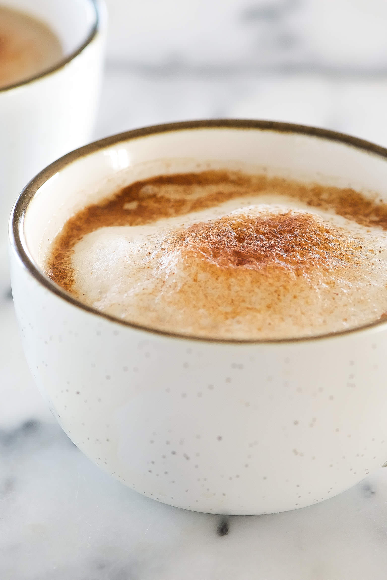 Homemade Cinnamon Dolce Latte Recipe is the best way to sip a coffeehouse favorite from the comfort of your own home! Made lighter with coconut sugar, homemade cinnamon syrup, and milk!