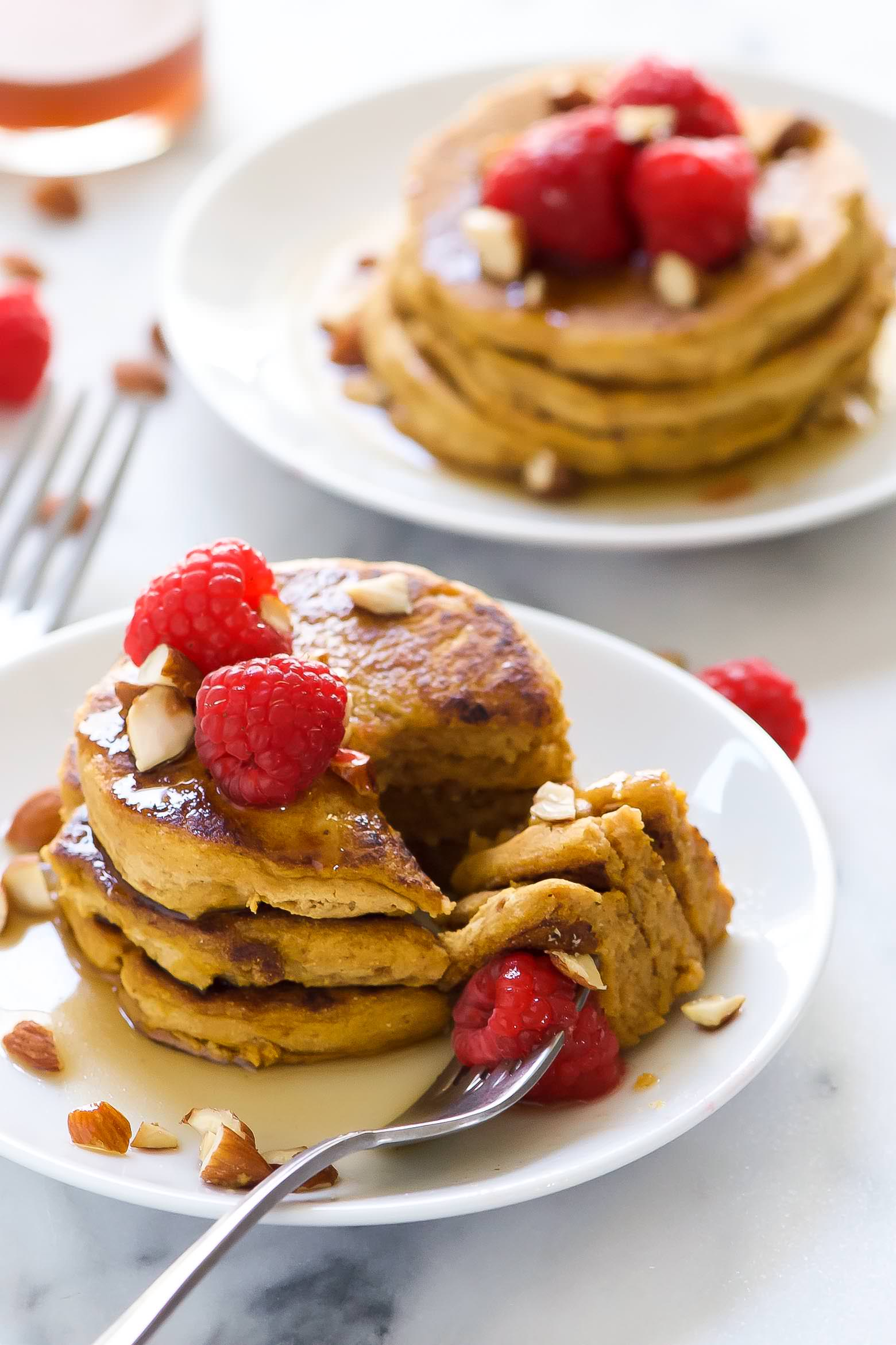 Gluten Free Pumpkin Pancakes are filled with fall flavors! They are super fluffy, have a touch of sweetness and finished with a warm coconut maple syrup! The ideal fall breakfast!