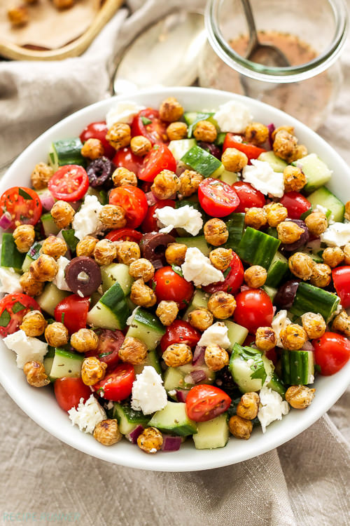 Crispy pan sautéed chickpeas add flavor, crunch and protein to this delicious, gluten-free Greek Tomato Cucumber Salad with Crispy Chickpeas!