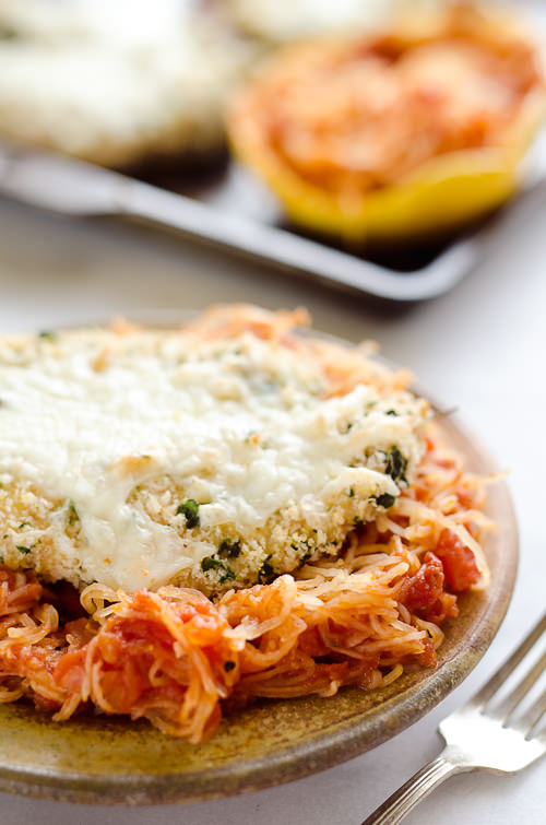Skinny Spaghetti Squash Chicken Parmesan is a healthy twist on the traditional classic. Lightly breaded chicken breasts are baked and served with low-carb spaghetti squash and marinara for a comforting dinner your family will ask for again and again!