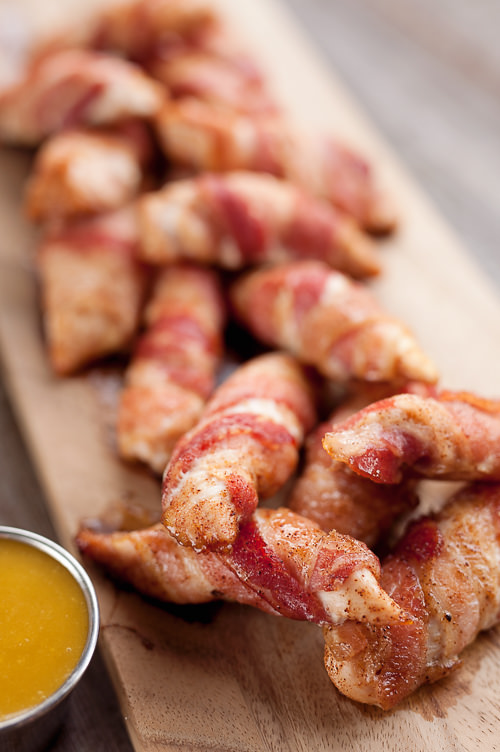 Sweet & Spicy Bacon Wrapped Turkey Tenders are a delicious appetizer paired with a homemade honey mustard for the ultimate game day finger food! This easy four ingredient meal also makes a great dinner idea with a side of rice and veggies.