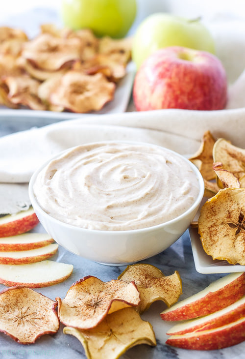 Baked apple chips sprinkled with cinnamon and sugar are perfect for dipping into this creamy cookie inspired snickerdoodle dessert dip!