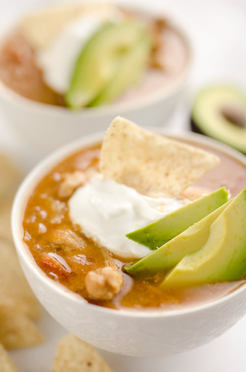 Pressure Cooker Chicken Tortilla Soup is a healthy and easy 30-minute soup recipe made in your Instant Pot that is bursting with bold and spicy flavors!