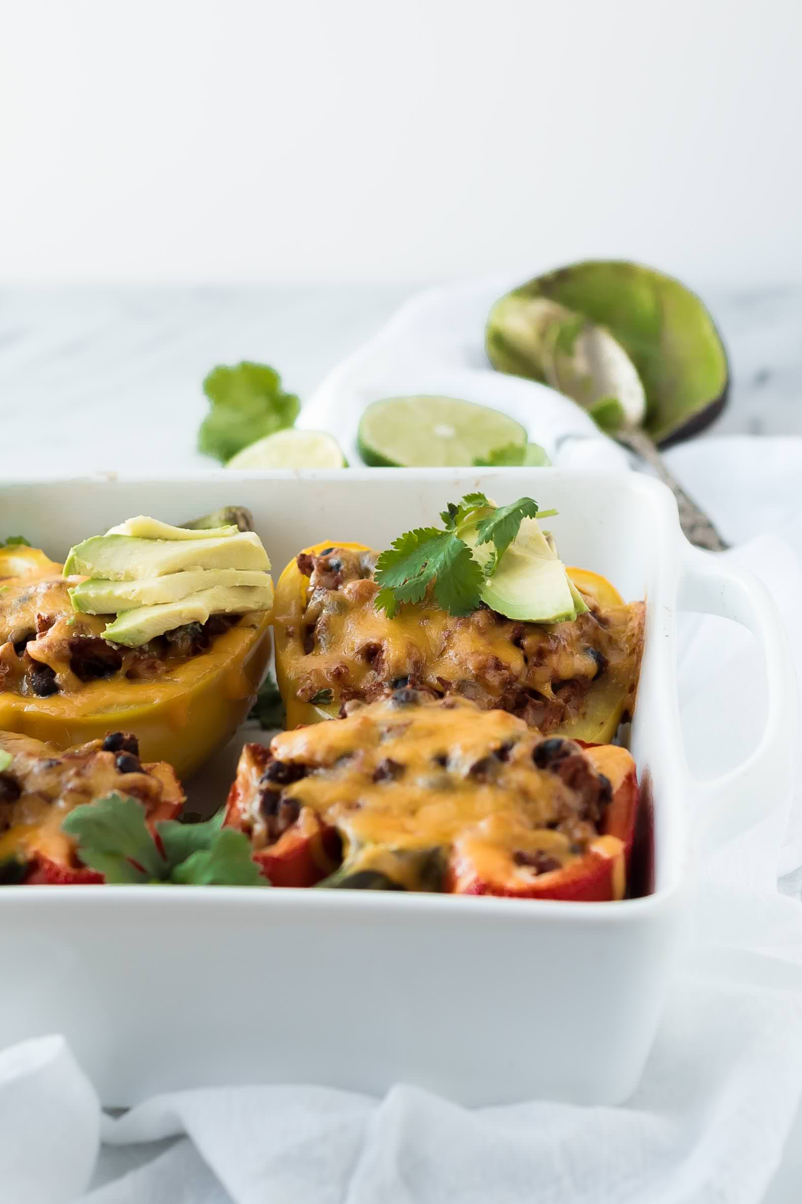 cauliflower rice stuffed peppers, low carb, cheese, gluten free, tomatoes, comfort food, chicken, mexican, easy, cheesy, recipe, black beans