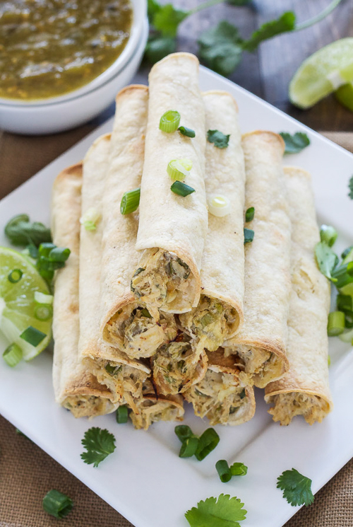 Baked Green Chile Chicken Taquitos are healthier and stuffed with the creamiest chicken and green chile filling!