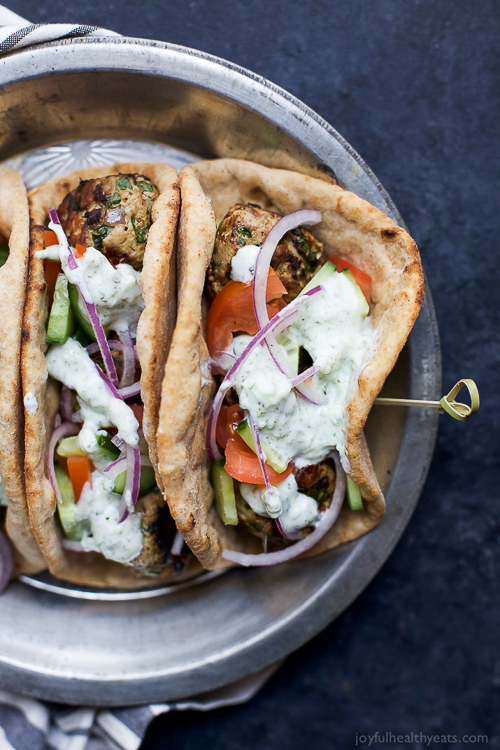 30 Minute Greek Turkey Meatball Gyros topped with a classic Tzatziki Sauce you'll want to swim in! These Gyros are the perfect healthy dinner option for the family and clock in 429 calories! Woohoo!